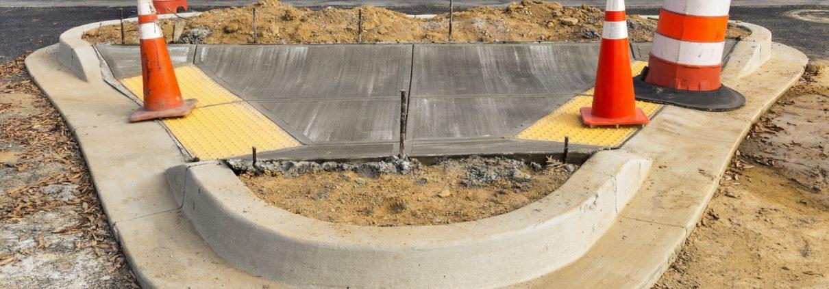 wet concrete on new sidewalk construction