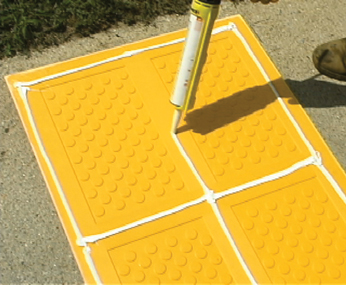 Applying Glue on Surface Applied Detectable Warning System for Installation