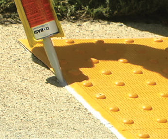 Gluing Surface Applied Detectable Warning System During Installation