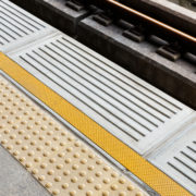 Blind floor tiles on train station platform