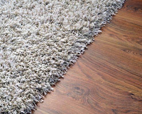 White Carpet on brown Wooden Floor