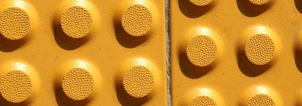Yellow Tactile Paving For The Blind Handicap