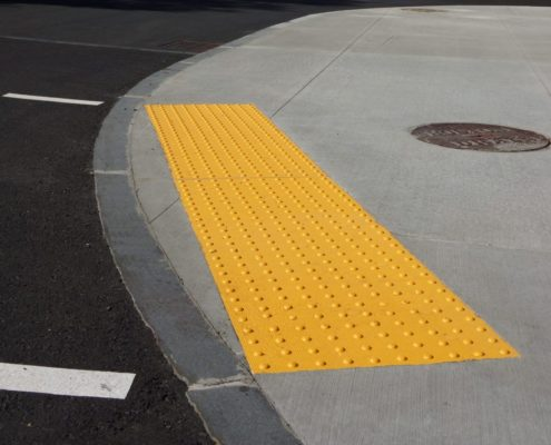 tactile paving with textured ground surface with markings