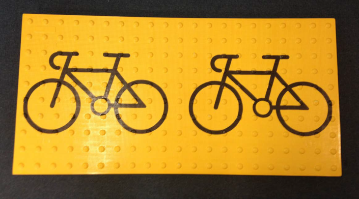 Bicycle Graphic on Yellow Tactile Surface