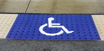 Blue Tactile Warning Surface with Handicap Logo Graphic