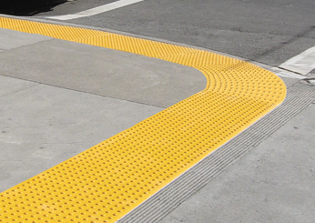Curved Detectable Warning Tiles at Street Corner
