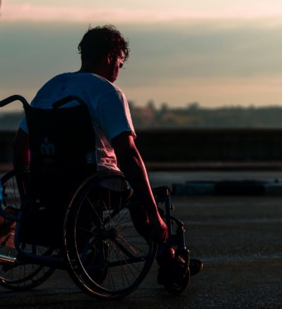 Disabled Athlete in Wheelchair at Sunset