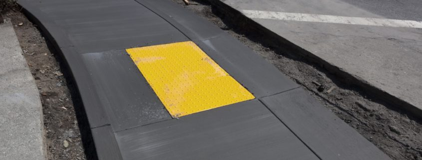 newly paved sidewalk with detectable warning system