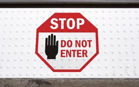 Stop Do Not Enter Sign on White ADA Tile Surface
