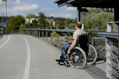 wheelchair user at barrier free accessible overpass