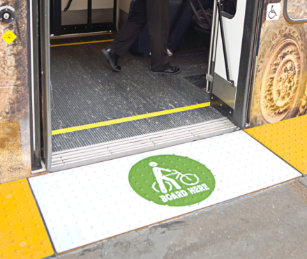 White ADA Tile Surface With Green Graphic for Wheelchairs