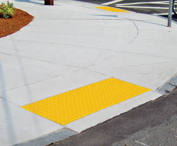 Yellow Cast-In Place Detectable Warning Tiles Leading to Street