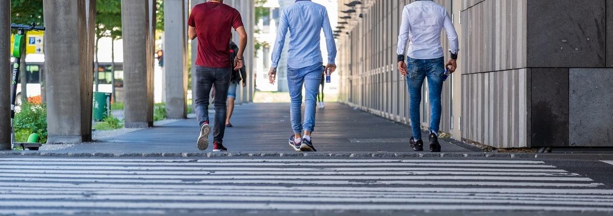 3 men walking on hallway