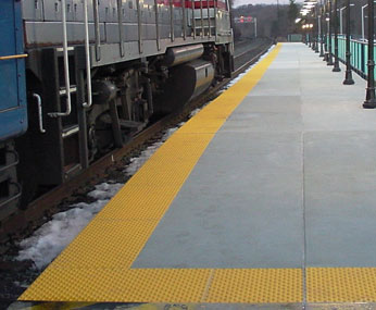 ADA Solutions Surface Applied Tactile Tiles in use at a train station.