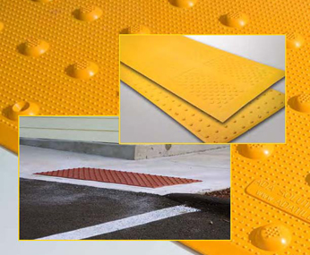 An ADA Solutions LLC Surface Applied Tactile Tile in use at a pedestrian crossing.