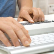 Visually impaired working on computer with assistive technology