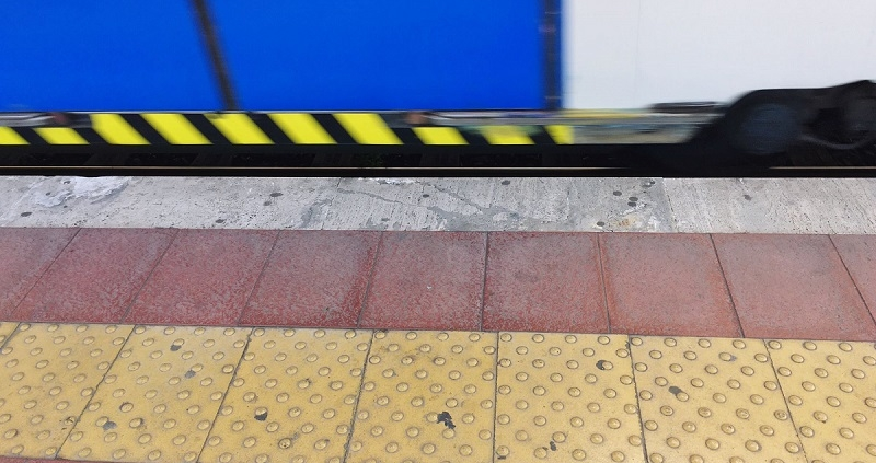 Tactile Paving On Railroad Station Platform By Train