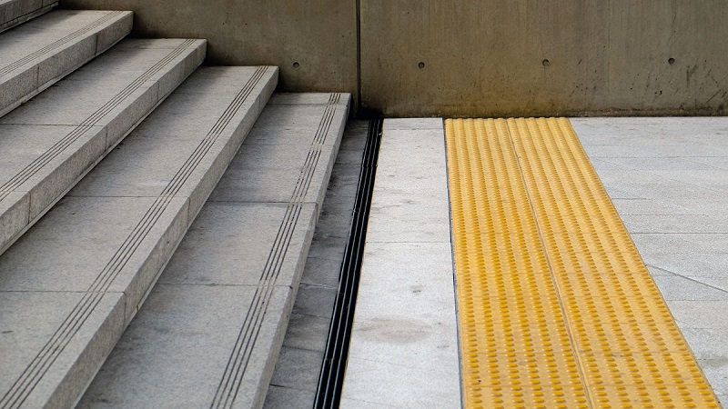 yellow Tactile paving to assist pedestrians