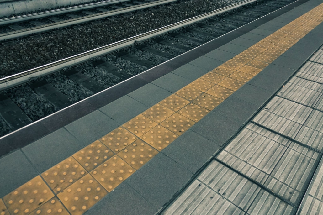 Yellow warning line in a station